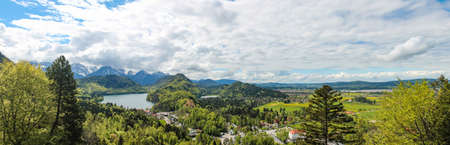 view of the Alpsee lake neighborhood near the Neuschwanstein castle in Bavaria Stitched Panorama Standard-Bild