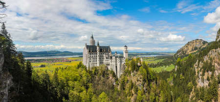view of the Neuschwanstein castle and surroundings in Bavaria Stitched Panorama Editorial