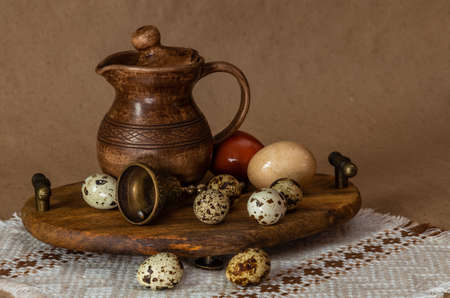 Festive Easter still life with eggs and earthenware jug. Blank for postcards. Banco de Imagens