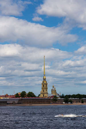 The view from the Neva on the famous Peter and Paul Cathedral and the wall of the Peter and Paul Fortress. St. Petersburg. Russia.