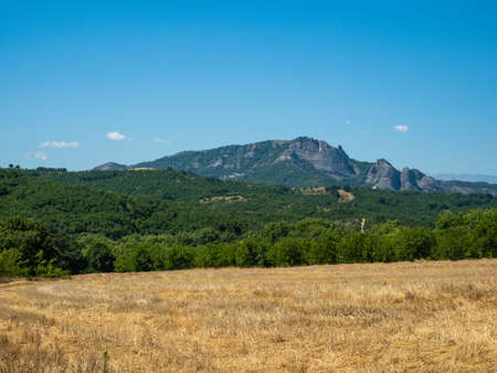 Beautiful landscape with fields, forests and mountains in Greece