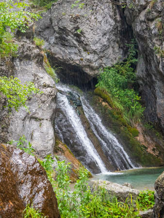 Mountain stream with a waterfall on the way to an exciting challenging walk while climbing Mount Olympus in Greece