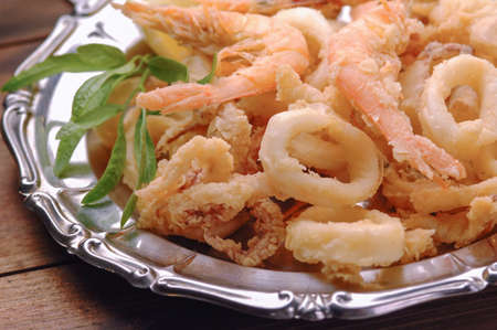 Fried shrimps and calamari photo