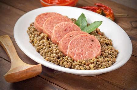 Italian cotechino with lentils on christmas table Stock Photo
