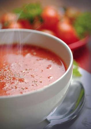 Creamy tomato soup in white bowl