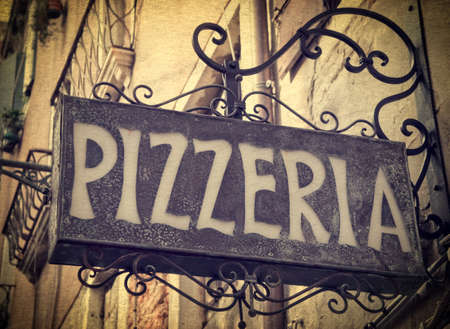 pizzeria: Vintage pizzeria sign in Venice Italy Editorial