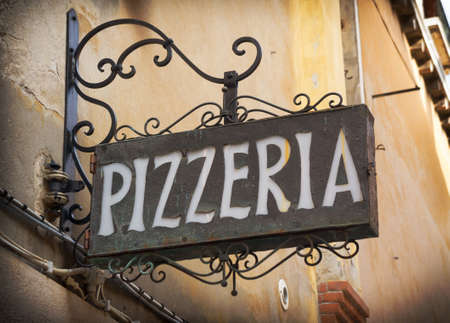 taverns: Vintage pizzeria sign in Venice Italy Editorial