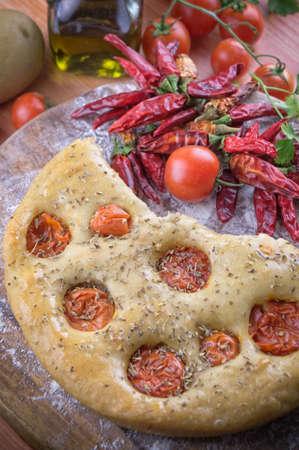 Italian focaccia with cherry tomatoes photo