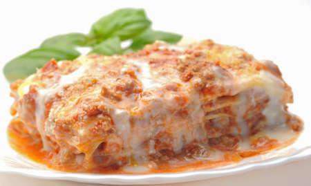 a portion: Closeup portion of lasagna