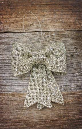 silver ribbon: Silver ribbon on wooden table