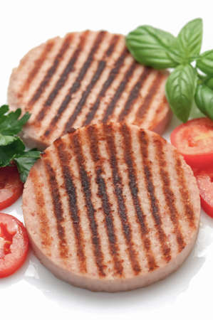 l plate: Grilled ham burger with fresh tomatoes