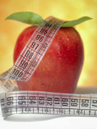 centimeter: Red apple and leaves with centimeter Stock Photo