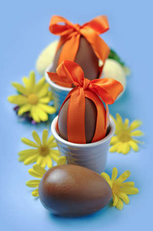 chocolate eggs: Easter chocolate eggs with fresh flowers Stock Photo