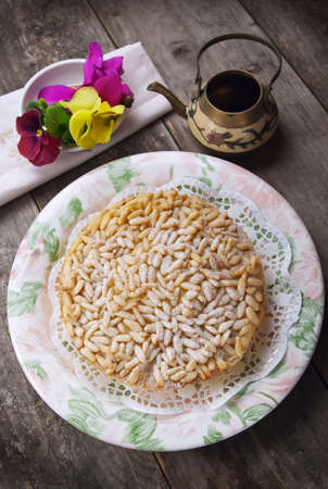 pine nut: Pine nut cake on wooden table