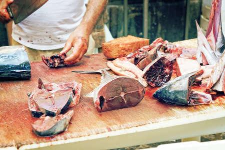 catania: Swordfish seller on the local market in Catania, Sicily