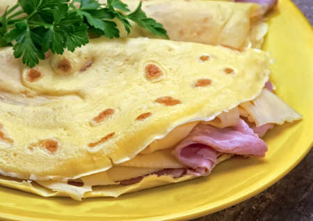 Crepes with ham and cheese closeup Stock Photo