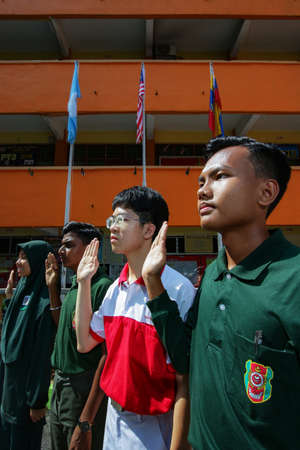 KUALA LUMPUR, MALAYSIA - MARCH 04, 2020. The group of secondary  school student from different ethnic background stood while reciting Malaysia's national commandment in Kuala Lumpur, Malaysia.
