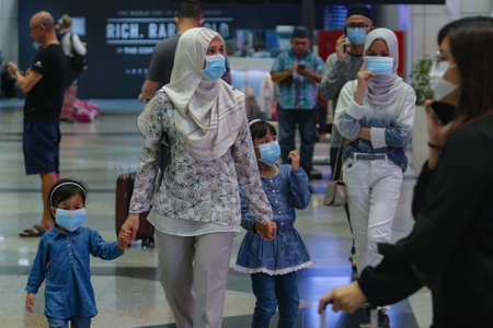 SEPANG, MALAYSIA - MARCH 07, 2020. Local people wearing protective masks following an outbreak of the coronavirus disease (COVID-19) at the KLIA in Sepang, Selangor.