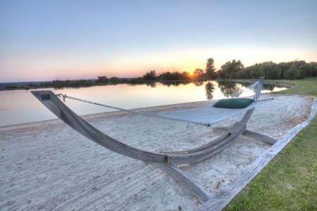 High Dynamic Range  HDR  hammock by pond at sunset Reklamní fotografie