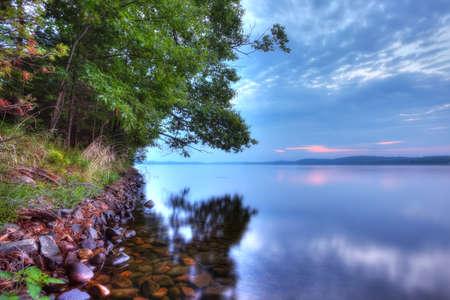 north woods: north woods shoreline at sunrise Stock Photo