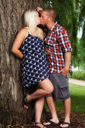 Happy young attractive couple kissing
