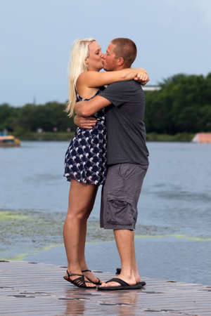 Happy young attractive couple kissing photo