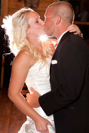 Happy young attractive newlyweds kissing photo