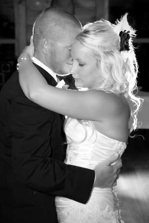 Happy young attractive newlyweds dancing black and white photo