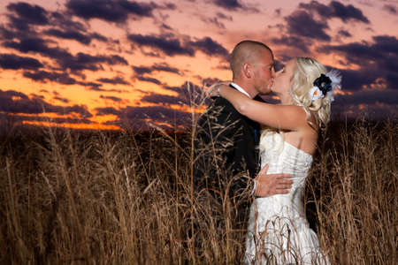 Happy young attractive newlyweds photo