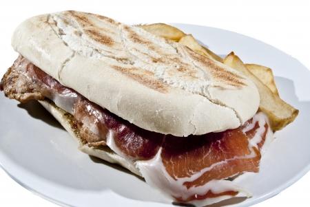 steak sandwich with ham pork ham and chips photo