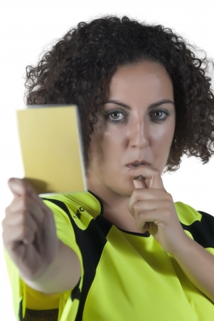 woman dressed as a referee with a whistle and card in hand photo