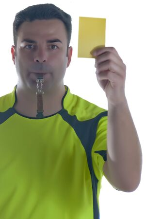 man dressed as a referee with a whistle and card in hand photo