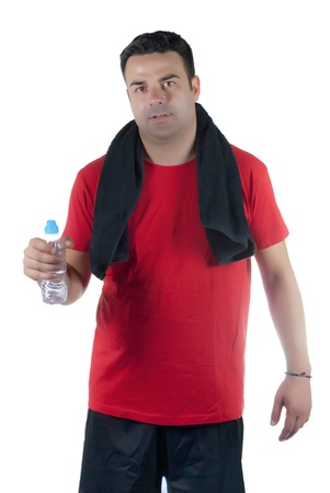 Young athlete with red shirt, black pants, black towel on his neck and a water bottle in hand Stock Photo - 14663358