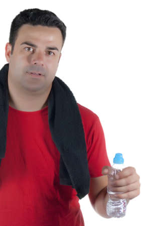Young athlete with red shirt, black towel on his neck and a water bottle in hand photo