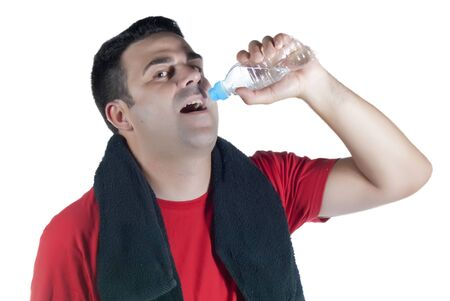 Young athlete with red shirt, black towel on his neck and a water bottle in hand Stock Photo - 14663347