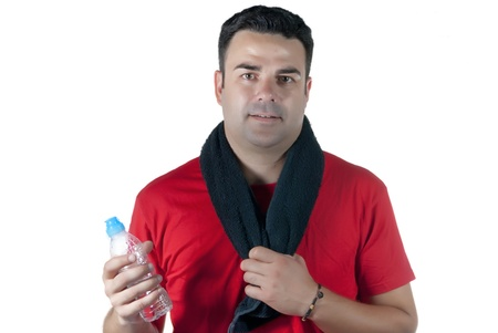 Young athlete with red shirt, black towel on his neck and a water bottle in hand Stock Photo - 14663343