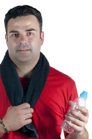 Young athlete with red shirt, black towel on his neck and a water bottle in hand Stock Photo - 14663363
