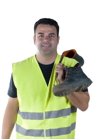 attractive man in work clothes and shoes, holding hands, smiling and happy in attitude, with white background photo