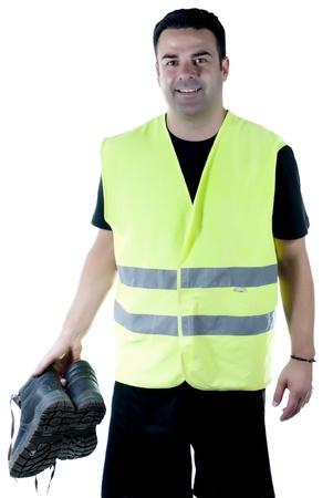 zapatos de seguridad: hombre atractivo en ropa de trabajo y calzado, de la mano, sonriente y feliz en la actitud, con fondo blanco