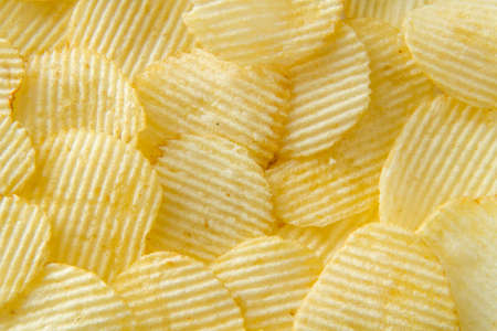 unhealthful: Potato chips background Stock Photo
