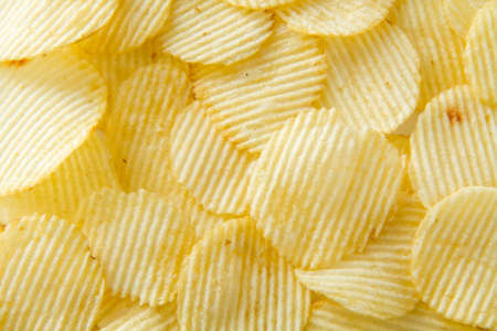 unhealthful: Potato chips background Stock Photo