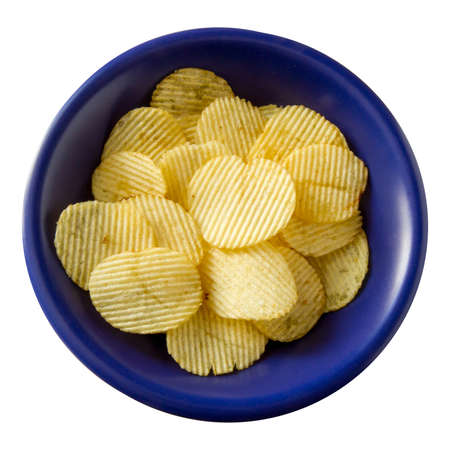 unhealthful: Potato chips in the blue bowl on white background Stock Photo