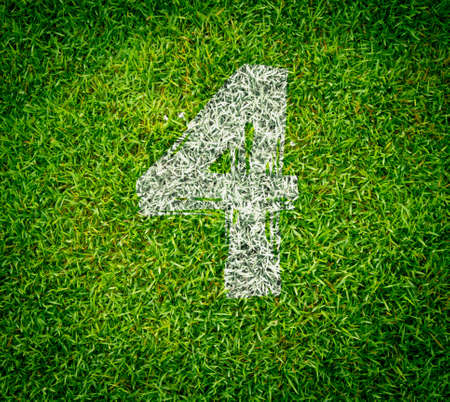 number collection - 4 on green grass seamless texture photo
