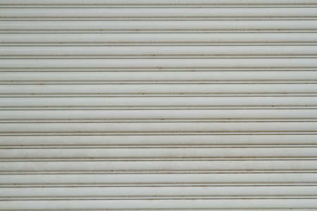 rolling garage door: Steel sliding doors  Metal sheet slide door texture Stock Photo