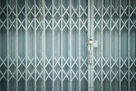 shutter door: Antique slide steel locked shutter door texture background Stock Photo