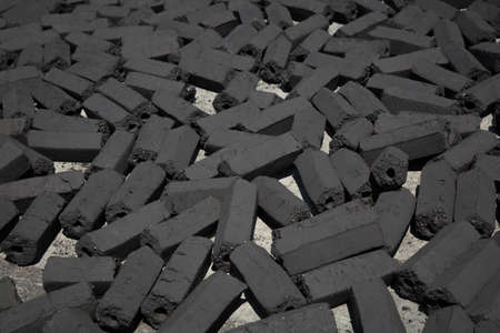 carbuncle: charcoal pack bar made from coconut shell background Stock Photo