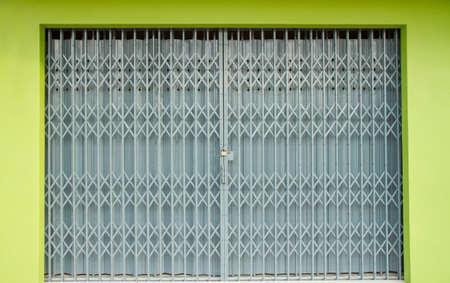 shutter door: Antique slide steel locked shutter door, texture background