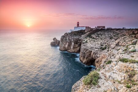 View of the lighthouse and cliffs at Cape St. Vincent at sunset. Picture taken in Sagres, Algarve, Portugal. Stock Photo