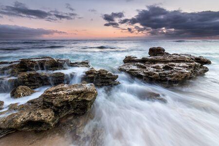 trafalgar: Waves crashing over rocks on the coast of Trafalgar, Cadiz, Spain Stock Photo