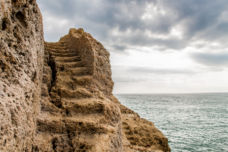 Staircase carved into the rock Coast in Carvoeiro, Algarve, Portugal Imagens - 47347639